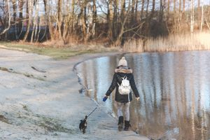 woman walking dog alone for social distancing and dogs blog